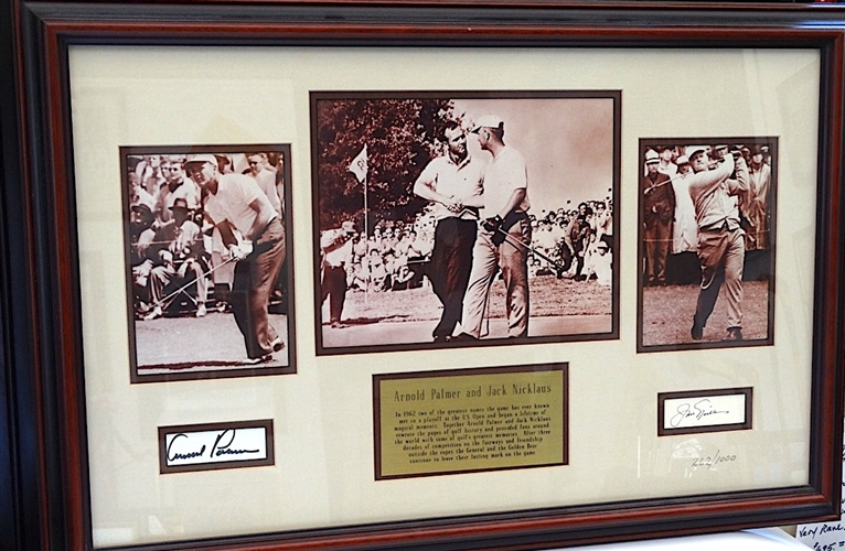 "SIGNED ARNOLD PALMER AND JACK NICKLAUS PHOTOS AND BRASS PLAQUE NOTING THEIR FRIENDSHIP AND ACHIEVEMENTS.SIZE 17.5"" X 25"""